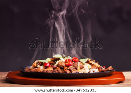 steaming chicken sizzler with noodles  - stock photo