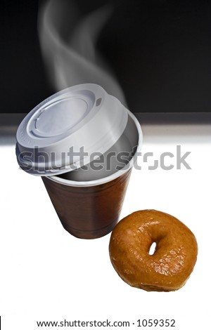 Steaming coffee and doughnut to go
