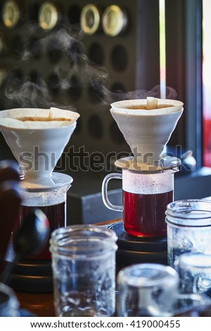 steaming coffee in a cafe - stock photo