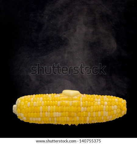 Steaming corn with melting butter (Clipping path on the corn included) - stock photo