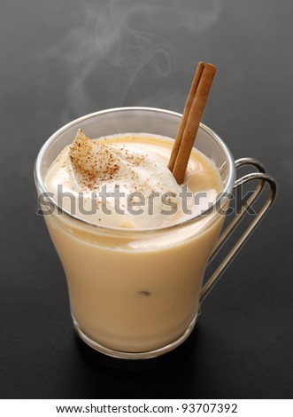 steaming eggnog on a black background - stock photo