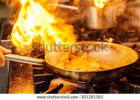Steaming food in the frying pan - stock photo