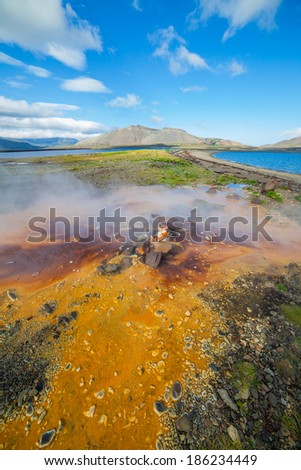 Steaming geothermal spring near Atlantic ocean in Volcanic Iceland - stock photo
