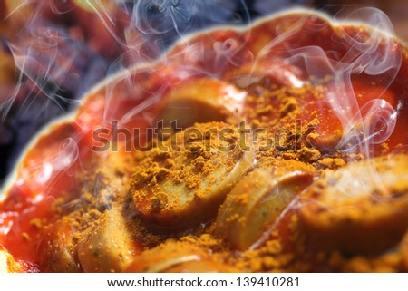 steaming hot currywurst - stock photo