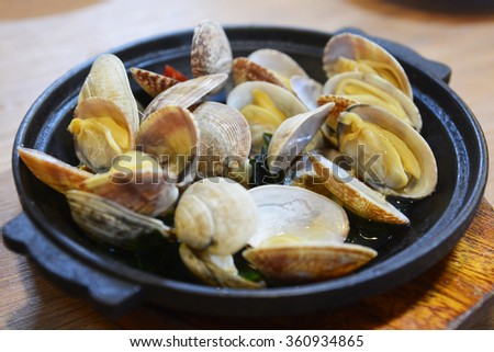 Steaming of the mussel is Japanese-style - stock photo