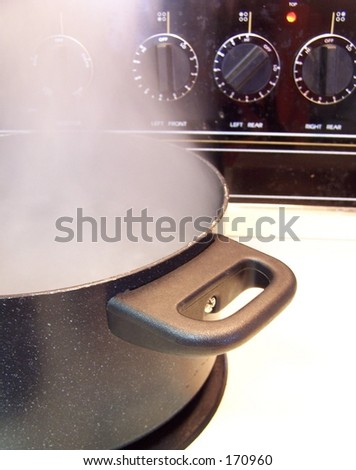 steaming pot on stove - stock photo