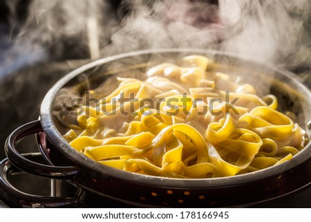 Steaming strainer of noodles - stock photo