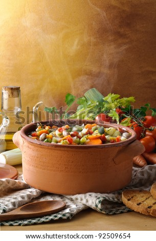 Steaming vegetables soup - stock photo