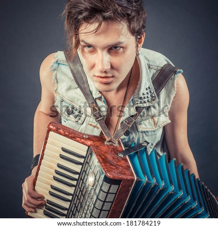 Steampunk accordion player - stock photo