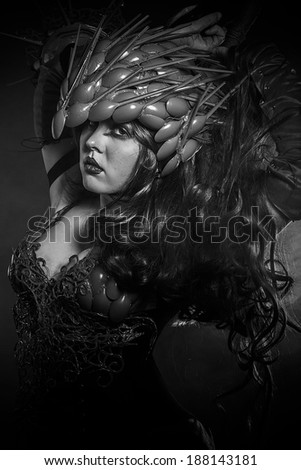 Steampunk, beautiful woman dressed in red armor dragon scales - stock photo