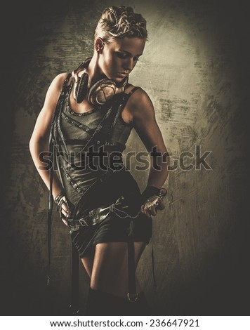 Steampunk girl looking at stopwatch - stock photo