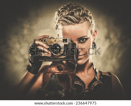 Steampunk girl with a retro camera - stock photo