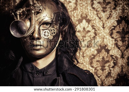 Steampunk man wearing mask with various mechanical devices.  Fantasy. - stock photo