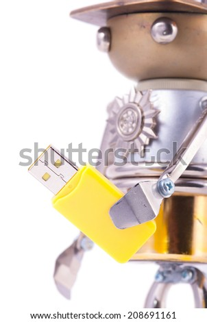 Steampunk robot holding flash memory stick. Chrome and bronze parts. Isolated on white. - stock photo