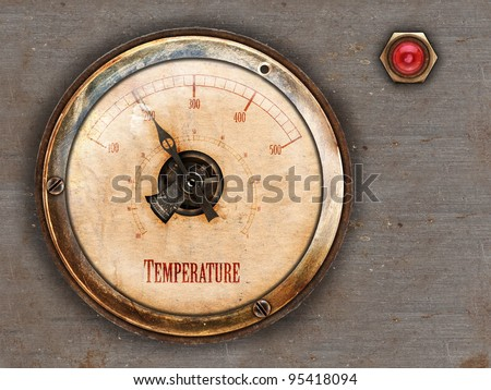 Steampunk themed vintage brass and copper gauge with red lamp on metal background