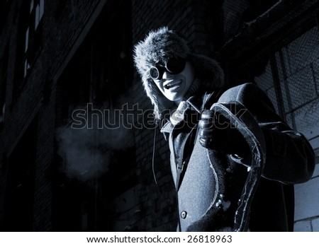 steampunker in industrial scary place - stock photo