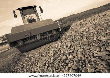 steamroller on a construction site in sepia - stock photo