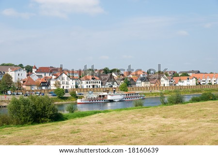Steamship on the Weser River with Fachwerkhaus background in Minden, Germany - stock photo