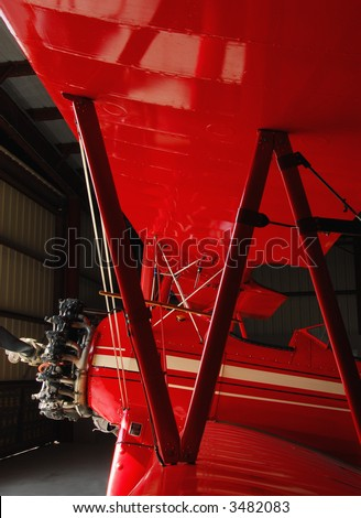 Stearman biplane in hangar - stock photo