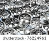 steel alloy car disks over the white background - stock photo