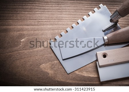 steel and rubber putty knifes and scrapper.