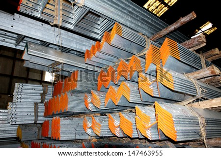 Steel angle bunch on the rack in warehouse - stock photo