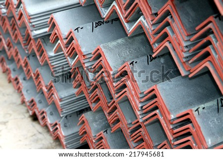 Steel angle bunch on the rack in warehouse before shipment - stock photo
