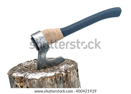 Steel axe with the black handle sticking out of timber on the background of snow - stock photo