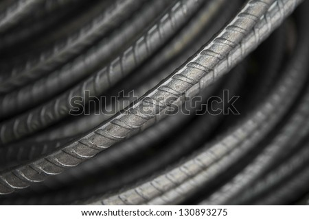 Steel bars close- up background. Reinforcing bar background - stock photo