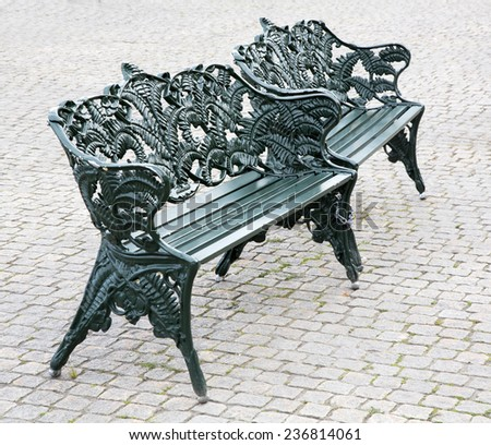 steel bench in the park on a stone bridge. green steel bench in the park green steel bench in the park - stock photo