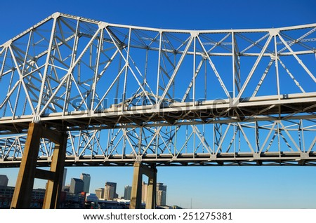 Steel bridge cross Mississippi River from New Orleans to West Bank, Louisiana, USA - stock photo