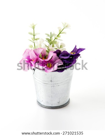 steel bucket with flower on white - stock photo