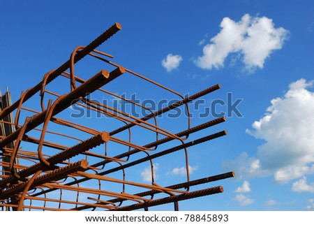 Steel building armature on blue sky background - stock photo