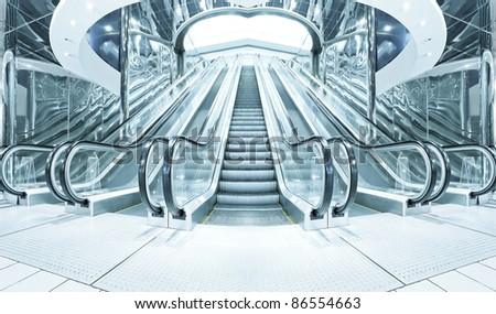 steel business hallway with wide escalators - stock photo