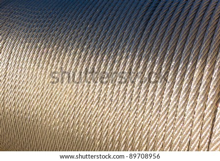 Steel cable roll on sunlight - stock photo