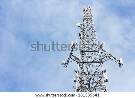Steel cellphone tower, perspective view. Upper part of tall structure soaring into blue sky with clouds. Successful wireless network communication concept. Horizontal photo. Room for text,copy space.  - stock photo