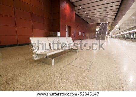 steel chair in a large lobby in hong kong - stock photo