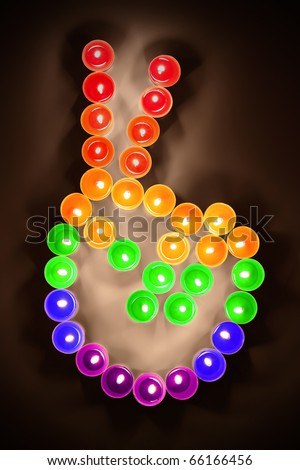 steel chips in rainbow colors shown the peace fingers symbol. - stock photo
