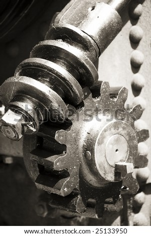 steel cogs and wheels photographed in black and white - stock photo