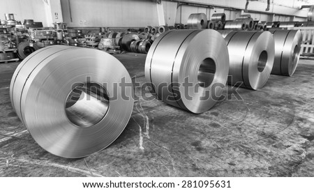 Steel coils inside industrial shed. - stock photo
