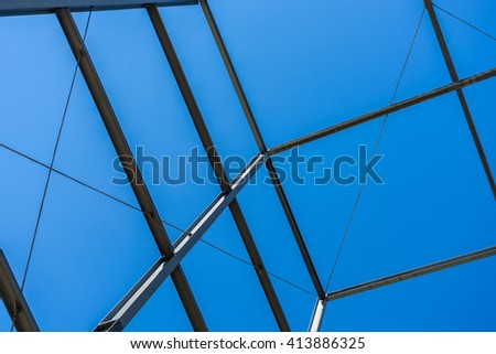 Steel construction with sky background. Modern business building construction. Steel construction site. Clear blue sky.