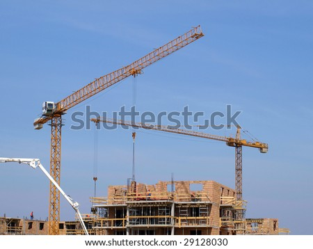 Steel crane at building site.