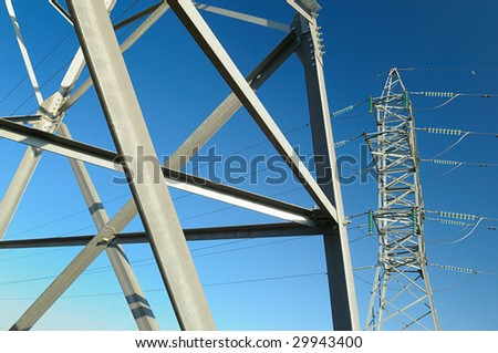 Steel design of high voltage transmission line against the sky.