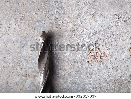 Steel drill on grunge background - stock photo