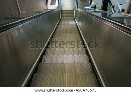 Steel escalator going down, downstairs