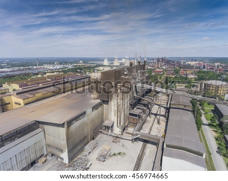 Steel factory with smokestacks at suny day.Metallurgical plant. steelworks, iron works. Heavy industry in Europe.Air pollution from smokestacks, ecology problems. Industrial landscape.View from above. - stock photo