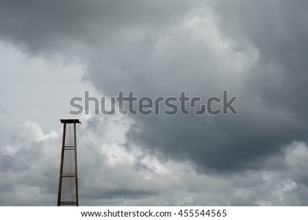 Steel frame in grey cloudy sky background  before raining.
