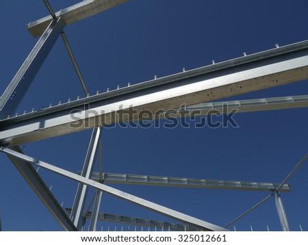 steel framework frame structure  blue sky - stock photo