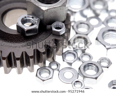Steel gear and nuts on plain background