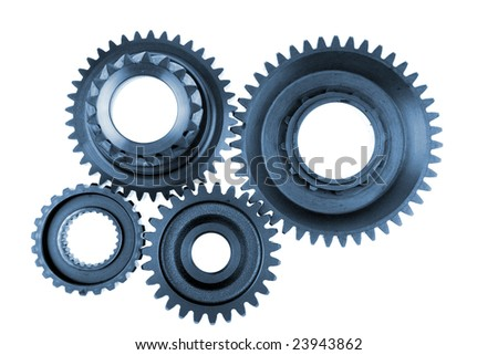 Steel gears meshing together over white - stock photo